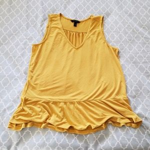 Flattering yellow top.